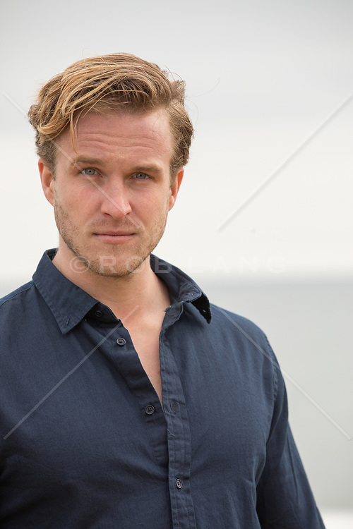 Portrait of a handsome man with blue eyes and blond hair