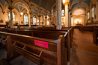 Every other pew is blocked off from seating to keep with the social distancing guidelines at Sacred Heart Church in Laconia.  (Karen Bobotas/for the Laconia Daily Sun)