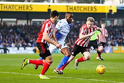 Abu Ogogo of Bristol Rovers is challenged by Reece James and Grant Leadbitter of Sunderland - Rogan/JMP - 23/02/2019 - FOOTBALL - Memorial Stadium - Bristol, England - Bristol Rovers v Sunderland - EFL Sky Bet League One.