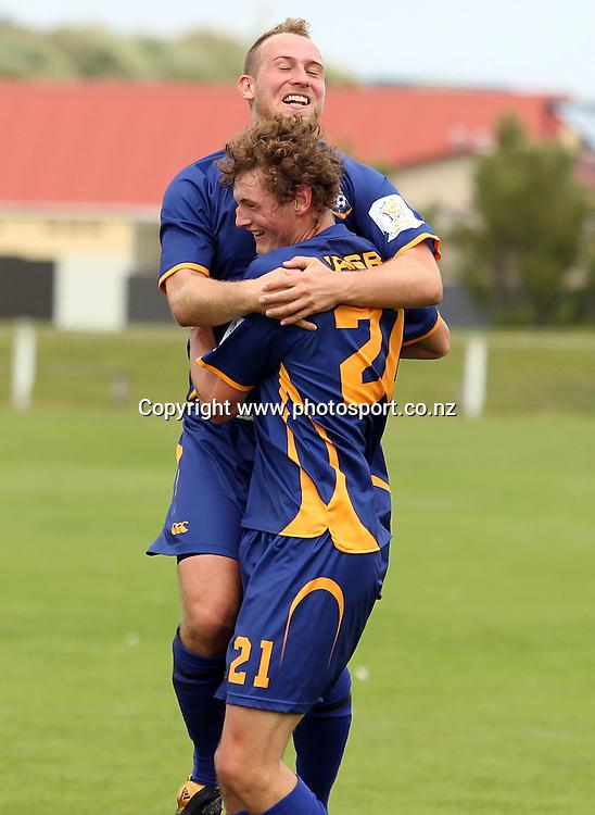 Otago United's Liam Lockhart is congratulated on his goal by Tom Sadd.<br /> ASB Premiership Football - Otago United v Youngheart Manawatu, 13 February 2011, Tahuna Park, Dunedin, New Zealand.<br /> Photo: Rob Jefferies / www.photosport.co.nz