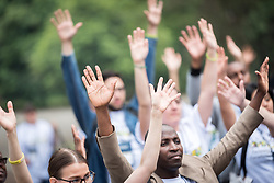"""7 March 2018, Arusha, Tanzania: On 7 March, students of GETI 2018 planted trees as part of a Service Learning day in their study programme. The trees mark a symbol of unity, and of working together for a greener planet, and a sustainable future. In a preceding prayer sessions the students all raised their hands into the air, becoming a symbolic forest, part of the planet and the ecosystems of the Earth. From 5-13 March 2018, the World Council of Churches organizes a Global Ecumenical Theological Institute (GETI) in Arusha, Tanzania, themed """"Translating the Word, Transforming the World"""". The GETI brings together young theologians from around the world for an intense academic study course in Ecumenical Missiology. GETI 2018 takes place in connection with the Conference on World Mission and Evangelism, also organized in Arusha, Tanzania."""