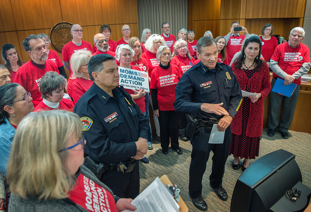 em013018l/a/Albuquerque Police Chief Michael Geier, right, and Deputy Chief Harold Medina, take part in a news conference with members of Moms Demand Action at the State Capitol in Santa Fe, Tuesday  January 30, 2018. The group is pushing for a memorial to encourage the FBI to notify New Mexico law enforcement when someone who is not allowed to have a gun tries to buy one. Sen. Linda Lopez, D-Albuquerque, right, is supporting the memorial but is not a sponsor. (Eddie Moore/Albuquerque Journal)