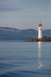 North America, United States, Washington, San Juan Islands, lighthouse and reflection in sea