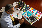 A State Bar of Wisconsin Leadership team member looking at a new magazine design. (Photo © Andy Manis)