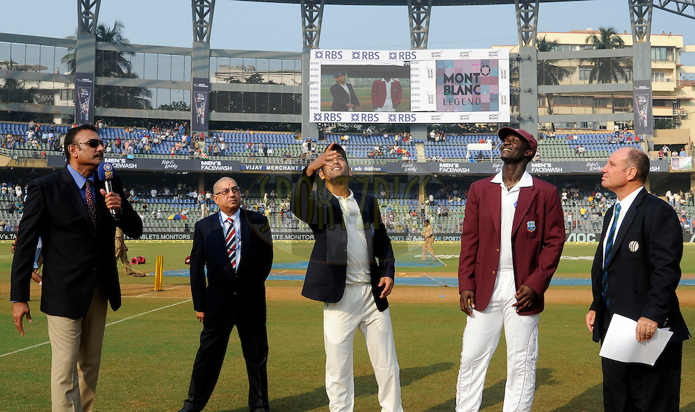 Mahendra Singh Dhoni captain of India  and Darren Sammy captain of West Indies during the toss before the start of day one of the second Star Sports test match between India and The West Indies held at The Wankhede Stadium in Mumbai, India on the 14th November 2013<br /> <br /> This test match is the 200th test match for Sachin Tendulkar and his last for India.  After a career spanning more than 24yrs Sachin is retiring from cricket and this test match is his last appearance on the field of play.<br /> <br /> Photo by: Pal PIllai - BCCI - SPORTZPICS<br /> <br /> Use of this image is subject to the terms and conditions as outlined by the BCCI. These terms can be found by following this link:<br /> <br /> http://sportzpics.photoshelter.com/gallery/BCCI-Image-Terms/G0000ahUVIIEBQ84/C0000whs75.ajndY