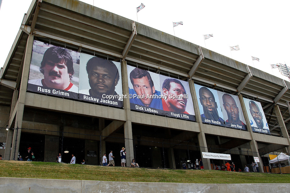 A banner features NFL Pro Football Hall of Fame Class of 2010 Inductees including former Washington Redskins guard Russ Grimm, former New Orleans Saints linebacker Rickey Jackson, former Detroit Lions cornerback Dick LeBeau, former Denver Broncos running back Floyd Little, former Minnesota Vikings defensive tackle John Randle, former San Francisco 49ers wide receiver Jerry Rice, and former Dallas Cowboys running back Emmitt Smith hangs on the outside of the stadium prior to the preseason football game between the Dallas Cowboys and the Cincinnati Bengals on Sunday, August 8, 2010 in Canton, Ohio. The Cowboys won the game 16-7. (©Paul Anthony Spinelli)