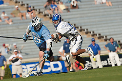 26 April 2009: North Carolina Tar Heels defends Duke defenseman CJ Costabile (9) during a 15-13 loss to the Duke Blue Devils during the ACC Championship at Kenan Stadium in Chapel Hill, NC.