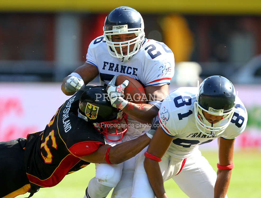 16.07.2011, Ernst Happel Stadion, Wien, AUT, American Football WM 2011, Germany (GER) vs France (FRA), im Bild tackle from Matthias Eck (Germany, #26, DB) against Laurent Marceline   (France, #28, RB ) and he falls on Bounouar Mellak  (France, #81, REC )  // during the American Football World Championship 2011 game, Germany vs France, at Ernst Happel Stadion, Wien, 2011-07-16, EXPA Pictures © 2011, PhotoCredit: EXPA/ T. Haumer