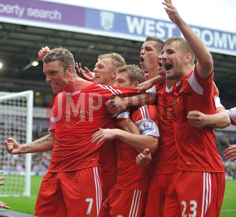 Southampton's Rickie Lambert celebrates after scoring  a penalty to make it 1-0  - Photo mandatory by-line: Alex James/JMP - Tel: Mobile: 07966 386802 17/08/2013 - SPORT - FOOTBALL - The Hawthorns - West Bromwich -  West Brom V Southampton - Barclays Premier League