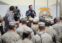 STRICT EMBARGO UNTIL 1800HRS 04 JULY 2011© Licensed to London News Pictures. 04/07/2011.Camp Bastion, Afghanistan. British Prime Minister David Cameron visits ISAF personnel in Camp Bastion, Afghanistan today (4 Jul 11).  The PM met with British and US troops and addressed them at a fourth of July service held in Camp Leatherneck, which is the US contingent within Bastion. See special instructions. Mandatory Photo credit : Sergeant Alison Baskerville/LNP