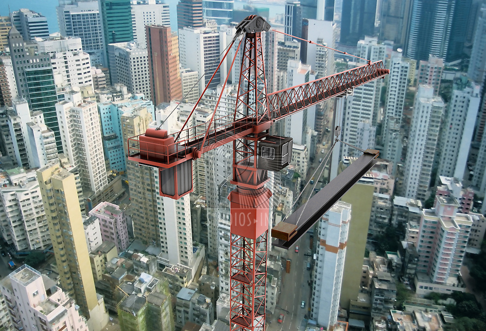 View of a construction crane from above looking down onto a metropolitain city scape during daytime
