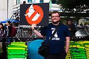 """A counter-protester shows off his """"KKK-busters"""" sign at the Freedom Rally at Westlake Park. Seattle, WA. August 13, 2017."""