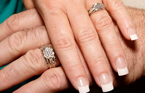 cindy thompson of miamisburg and her new husband show off their matching harley davidson wedding bands - Harley Wedding Rings