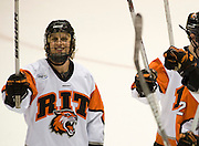 2010/03/19 - RIT's Daniel Spivak salutes the student section after a 4-0 victory over Canisius College in the Atlantic Hockey semifinal at the Blue Cross Arena in Rochester, N.Y. on March 19th, 2010.