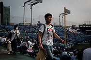 A Supporter of The Tokyo swallows looks for his seat at the Jingu Baseball Stadium in Tokyo before a game Tokyo Swallows VS Hiroshima Carp, Japan. 21/04/2017-Tokyo, JAPAN