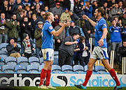 Portsmouths Adam McGurk celebrates his 2nd goal of the game with Christian Burgess during the The FA Cup match between Portsmouth and Macclesfield Town at Fratton Park, Portsmouth, England on 7 November 2015. Photo by Adam Rivers.