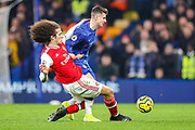 Arsenal midfielder Mattéo Guendouzi (29) tackles Chelsea midfielder Mason Mount (19) during the Premier League match between Chelsea and Arsenal at Stamford Bridge, London, England on 21 January 2020.