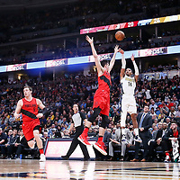 09 April 2018: Denver Nuggets guard Gary Harris (14) takes a jump shot over Portland Trail Blazers center Zach Collins (33) during the Denver Nuggets 88-82 victory over the Portland Trail Blazers, at the Pepsi Center, Denver, Colorado, USA.