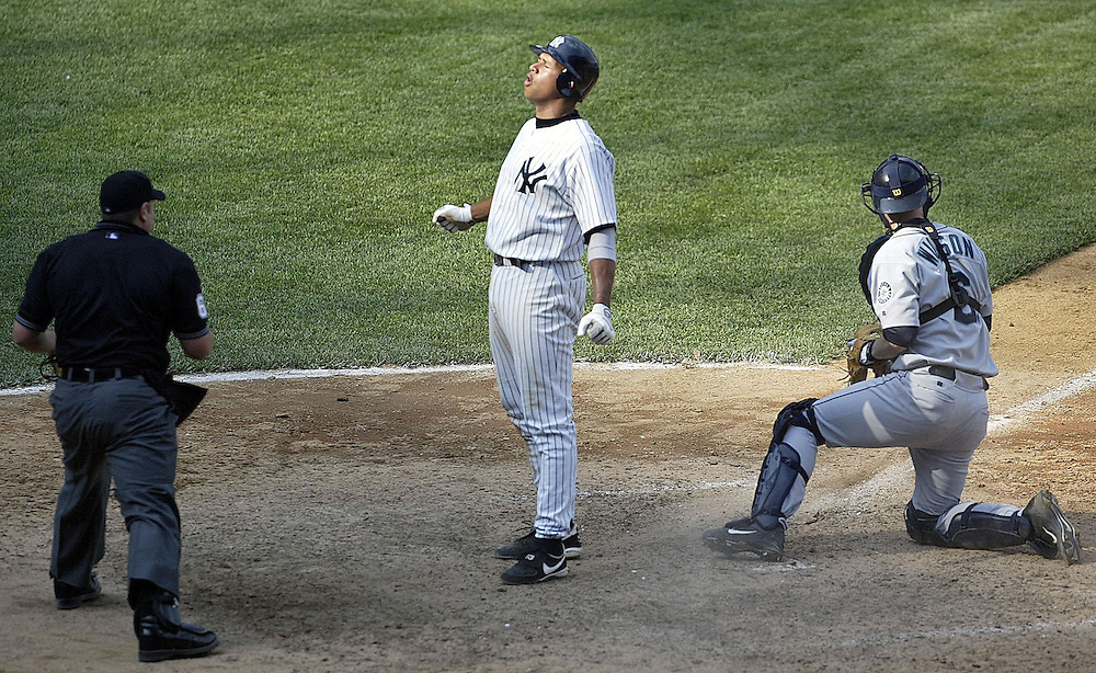 Alex Rodriguez (C) reacts after being taged out at home plate by Catcher Dan Wilson of the Seattle Mariners in the 12th inning in the Bronx, New York, Saturday 15 May 2004. EPA/Andrew GOMBERT<br />