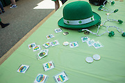 A table showcasing St. Patrick's Day decorations, including shamrock lights, a leprechaun hat, coins, and temporary tattoos, was featured at the St. Patrick's Day celebration hosted by the Office of Diversity and Inclusion on the fifth floor of Baker Center on March 17, 2016.