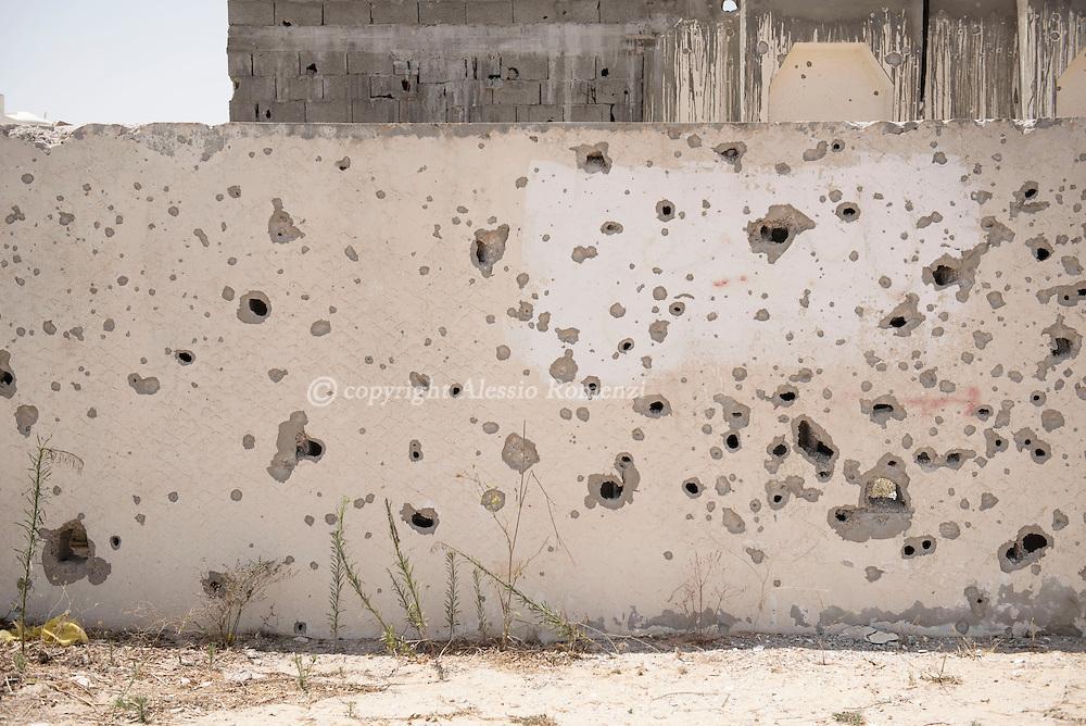 Libya: Riddled by gunshots and shrapnels wall in 700 neighbourhood in Sirte. Alessio Romenzi