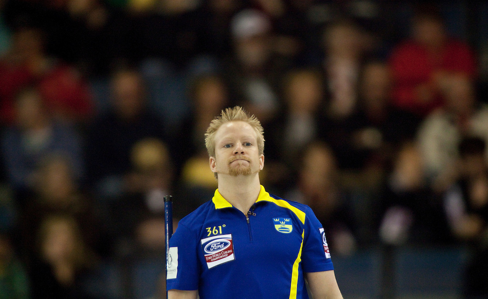 Swedish skip Niklas Edin takes a break during Sweden's 7-2 loss to Norway in the 3-4 page playoff draw at the Ford World Men's Curling Championships in Regina, Saskatchewan, April 9, 2011.<br /> AFP PHOTO/Geoff Robins