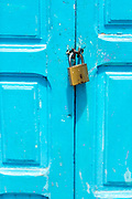 CHEFCHAOUEN, MOROCCO - 27th APRIL 2016 -  Close-up of blue doorway with padlock, Chefchaouen, Rif Mountains, Northern Morocco.