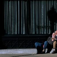 (Boston, MA - 1/19/15) One man comforts another on Stuart Street, Monday, January 19, 2015. Staff photo by Angela Rowlings.