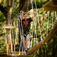 A young guest makes his way across an element at TreeHoppers Aerial Adventure Park on September 20, 2015 in Dade City. VISIT FLORIDA/Scott Audette