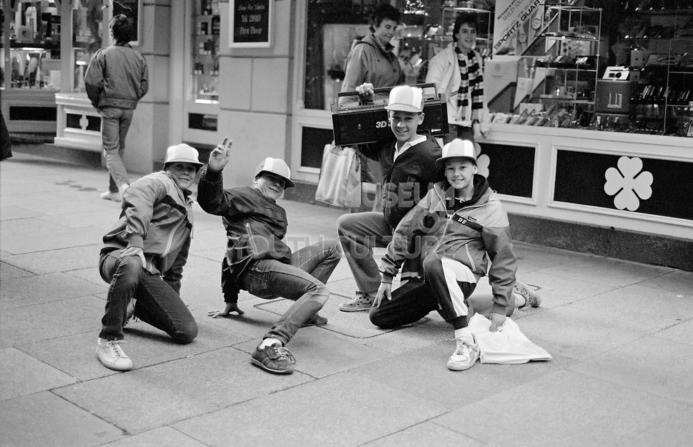 A young group of B Boy kids posing in the street with a Ghetto blaster, Guernsey, 1986