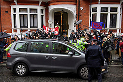 © Licensed to London News Pictures. 14/11/2016. London, UK. Swedish officials leave the Ecuadorian Embassy in London in a car during a lunch break in questioning of WikiLeaks editor-in-chief, Julian Assange. Assange, who has been living at the embassy for over four years, is wanted for questioning over accusations of rape in Stockholm in 2010.  Photo credit: Ben Cawthra/LNP