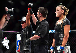 "Nov 12, 2016 - New York, New York, U.S. - Liz ""Girlrilla"" Carmouche (red gloves) vs. Katlyn ""Blonde Fighter"" Chookagian (blue gloves) during UFC 205 at Madison Square Garden. (Credit Image: © Jason Silva via ZUMA Wire)"