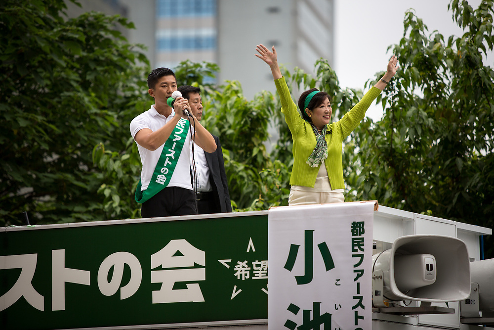 TOKYO, JAPAN - JULY 1: Tokyo Gov. Yuriko Koike, right, who also heads the Tokyo Citizens First party, waves her hands to voters from atop of a campaign van with party's members during election campaign for Tokyo Metropolitan Assembly on July 1, 2017 in Akihabara, Tokyo, Japan. (Photo: Richard Atrero de Guzman/NUR Photo)