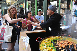 Customers queing up to buy paella from a stall in Borough Market whic has opened for the first time since the London Bridge terrorist attack.