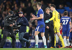 """Chelsea's Gary Cahill (left), Thibaut Courtois and Chelsea manager Antonio Conte after the final whistle during the Premier League match at Stamford Bridge, London. PRESS ASSOCIATION Photo. Picture date: Sunday November 5, 2017. See PA story SOCCER Chelsea. Photo credit should read: Nick Potts/PA Wire. RESTRICTIONS: EDITORIAL USE ONLY No use with unauthorised audio, video, data, fixture lists, club/league logos or """"live"""" services. Online in-match use limited to 75 images, no video emulation. No use in betting, games or single club/league/player publications."""