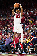 FAYETTEVILLE, AR - FEBRUARY 27:  C.J. Jones #23 of the Arkansas Razorbacks shoots a three pointer during a game against the Auburn Tigers at Bud Walton Arena on February 27, 2018 in Fayetteville, Arkansas.  The Razorbacks defeated the Tigers 91-82.  (Photo by Wesley Hitt/Getty Images) *** Local Caption *** C.J. Jones