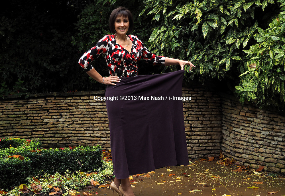 Kim Freshwater, 45, who lost 17st 5llb/110 kg and the slimming world woman of the year, shows the skirt she wore 2 and a half years ago, in London, United Kingdom. Tuesday, 12th November 2013. Picture by Max Nash / i-Images