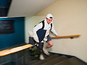 "13 MARCH 2020 - DES MOINES, IOWA: GAGE VANDERLEER, a first year student at Drake University, walks up the stairs to pack his car before going home for spring break. The Governor of Iowa announced Friday that 17 people in Iowa have tested positive for the Novel Coronavirus. Of those, 15 people were exposed on the same cruise in Egypt, the others were exposed through travel but were not on the same cruise. The Governor said there has not yet been any ""community spread"" in Iowa. All of the Iowans who have tested positive are in self quarantine. Across Iowa, municipalities and businesses are taking steps to implement ""social distancing."" Most of the colleges in Iowa, including Drake University, have announced that they will remain closed after their spring breaks and that classes will move to online only, after spring break. Many businesses in Des Moines, including Nationwide Insurance and EMC Insurance, have announced plans to have their employees to telecommute. The mayor of Des Moines has urged event planners to consider canceling large events.     PHOTO BY JACK KURTZ"