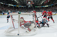 KELOWNA, CANADA - MAY 1: Adin Hill #31 of Portland Winterhawks defends the net as Nick Merkley #10 falls into him during third period of game 5 of the Western Conference Final on May 1, 2015 at Prospera Place in Kelowna, British Columbia, Canada.  (Photo by Marissa Baecker/Getty Images)  *** Local Caption *** Nick Merkley; Adin Hill; Tyson Baillie;