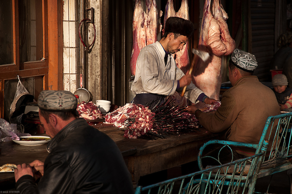 — A butcher prepares cuts of meat to cook in his restaurant or sell in the open market.