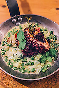 Braised octopus with fresh peas, cabbage and mint at A Terra restuarant at Praia Verde Boutique Hotel. Castro Marim, Alentejo