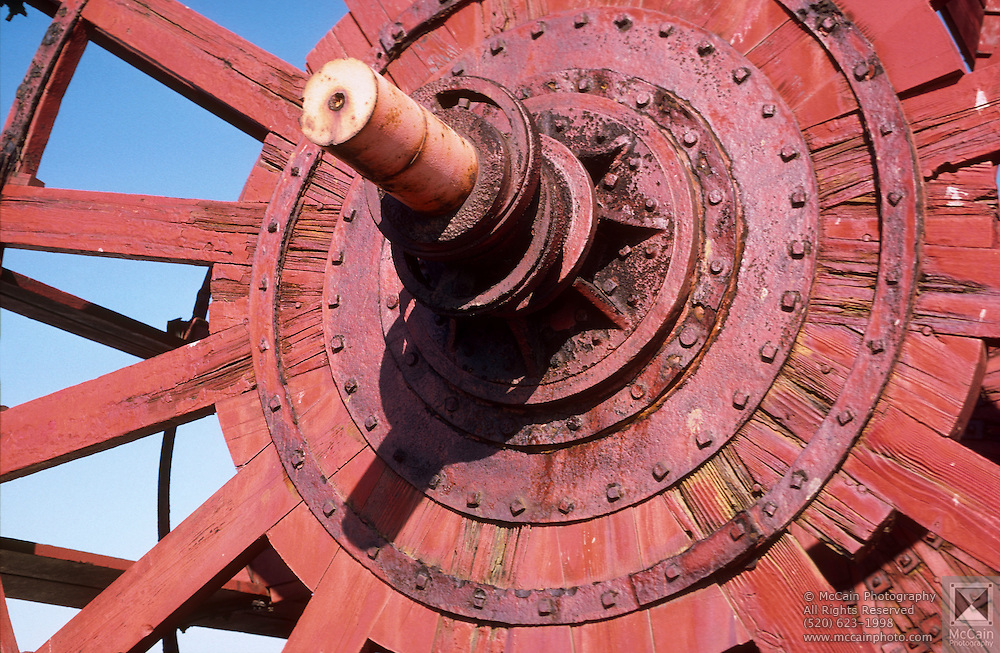 Close-up view of large wooden wheel by the wharf, San Francisco, California. ..Media Usage:.Subject photograph(s) are copyrighted Edward McCain. All rights are reserved except those specifically granted by McCain Photography in writing...McCain Photography.211 S 4th Avenue.Tucson, AZ 85701-2103.(520) 623-1998.mobile: (520) 990-0999.fax: (520) 623-1190.http://www.mccainphoto.com.edward@mccainphoto.com