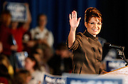 091508-Golden, Colo.-palin-Alaska Governor Sarah Palin waves to the crowd during her speech Monday, Sept. 15, 2008 in the Westernaires Arena at the Jefferson County Fairgrounds. An estimated 5000 people attended her speech..Photo By Matthew Jonas/Evergreen Newspapers/Photo Editor