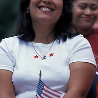 USA, Washington, Seattle, Woman smiles after being sworn in as US citizen at 4th of July Naturalization ceremony