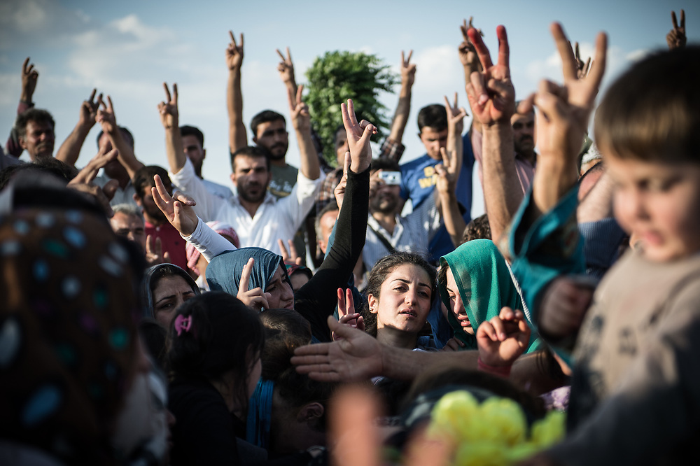 At Martyrs' Cemetery of Kobanê people mourning the death of five people who were killed in the battles against ISIS. Kobanê (Ayn al-Arab), Syria, June 15, 2015