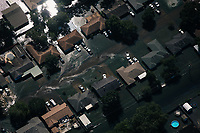 Polluted floodwater surrounds homes in Beaumont, Texas.