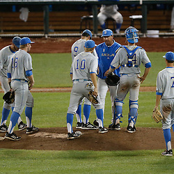 Jun 24, 2013; Omaha, NE, USA; UCLA Bruins head coach John Savage (22) comes to the mound during the seventh inning in game 1 of the College World Series finals against the Mississippi State Bulldogs at TD Ameritrade Park. Mandatory Credit: Derick E. Hingle-USA TODAY Sports
