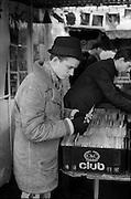 Neville looking at Records, Camden Market, London, UK, 1980s.