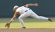 Texas shortstop Seth Johnston stretches for a ground ball against Tulane.  Texas defeated Tulane 5-0 in the second round of the College World Series at Rosenblatt Stadium in Omaha, Nebraska on June 20, 2005.