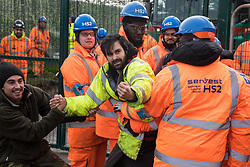 Harefield, UK. 8 February, 2020. HS2 engineers and security guards try to prevent environmental activists from Save the Colne Valley, Stop HS2 and Extinction Rebellion from accessing an area of Harvil Road fenced off in order to carry out tree felling works for the high-speed rail project. The activists were successful in preventing any of the scheduled tree felling by HS2 and after an intervention by a police officer all tree felling work has now been cancelled for the weekend.